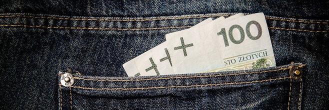 pieniądze wystające z kieszeni jako metafora zachowek spadkobiercy